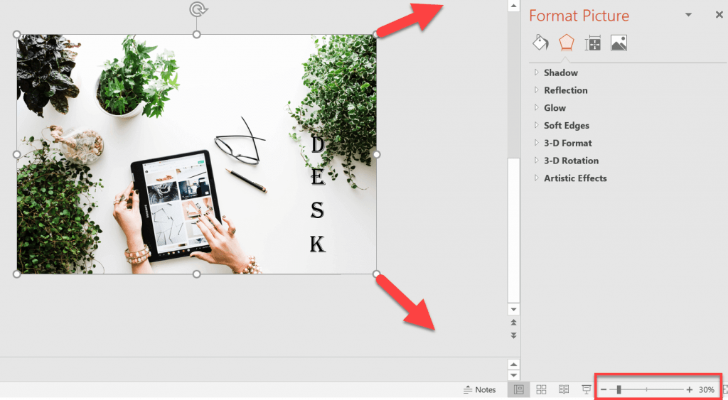 Zoom out of the slides so you can see clearly which part of your image is still on the slide canvas