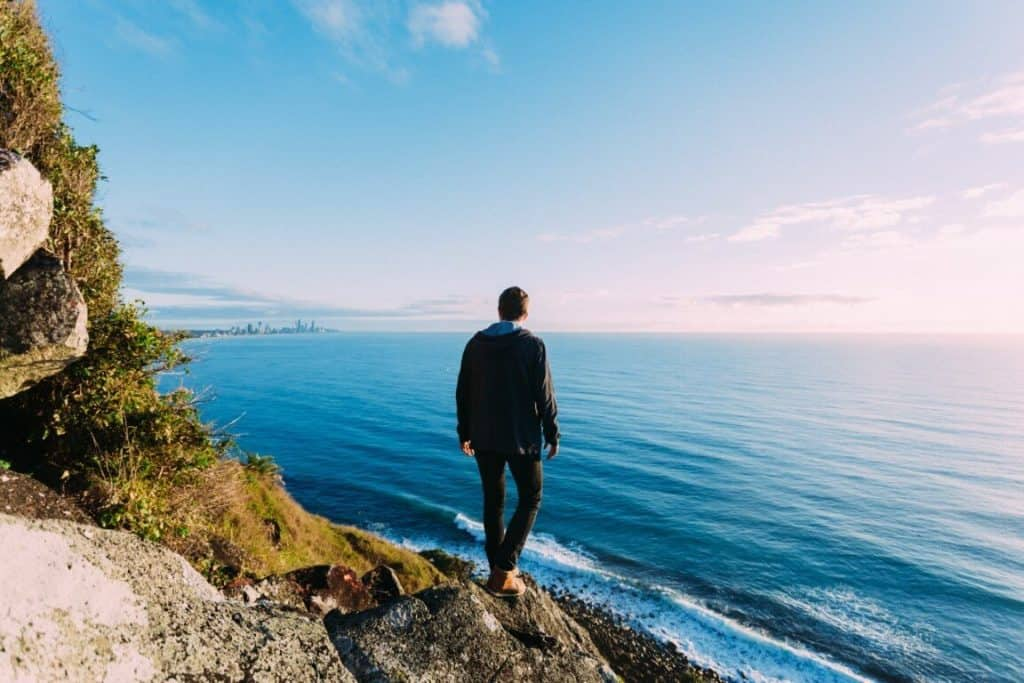 guy looking out into the vast blue ocean (blue ocean strategy)